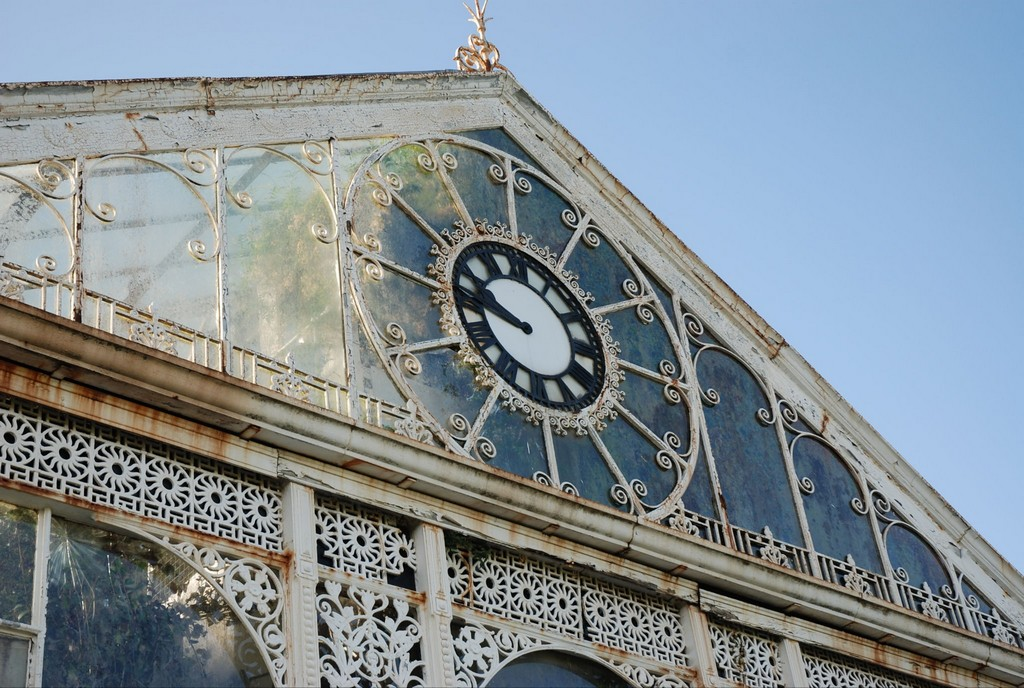 The clock and surrounding rusting intricate iron work in 2012